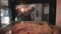 Man Microwave Meal in kitchen Stock Footage
