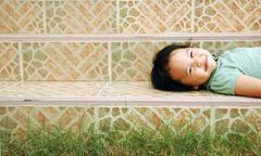 laying down kid - stock photo