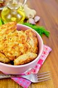 fritters chicken in a pink bowl on a napkin - stock photo