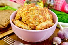 fritters chicken in a pink bowl on the board - stock photo