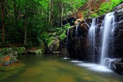waterfall in tropical forest - stock photo