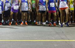 runners ready to run at starting point - stock photo