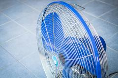 turn off industrial fan on blue floor - stock photo