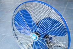 Front of industrial fan on blue floor Stock Photos