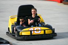 brother and sister on the go cart - stock photo