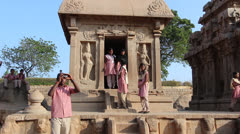 India Tamil Nadu Mahabalipuram Five Rathas young people at shrine entrance 9 Stock Footage