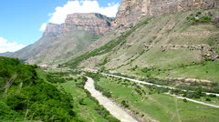 Gorge, mountain road, along the serpentine riding machine Stock Footage