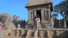 India Tamil Nadu Mahabalipuram Five Rathas young woman exits shrine 6 Stock Footage