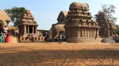 India Tamil Nadu Mahabalipuram Five Rathas shadows on red dirt 2 Stock Footage