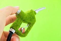hand holding eco fuel nozzle - stock photo