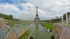 Eiffel Tower water cannons Paris, France, time lapse 4K UHD motion blur Stock Footage