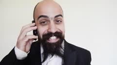 elegant long bearded blad man on the phone - stock footage