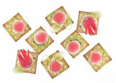 canapes with grape, strawberry, jelly and creme - stock photo
