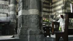 Woman praying, Church of Saint Peter, Portovenere Stock Footage