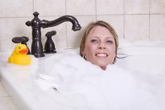 woman relaxing in the tub - stock photo