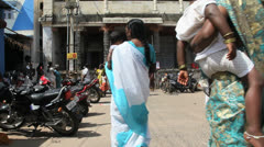 India Tamil Nadu Chidambaram women walk with child in arms 8 Stock Footage