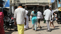 India Tamil Nadu Chidambaram people walk toward temple 4 Stock Footage