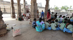India Tamil Nadu Chidambaram temple people sit near columns 6 Stock Footage