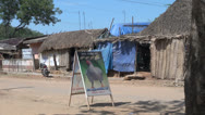 Stock Video Footage of India Tamil Nadu shacks with thatch roof and chicken sign 2