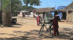 India Tamil Nadu village girls in burgundy with bikes Stock Footage