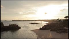 Sunset over coast Stock Footage