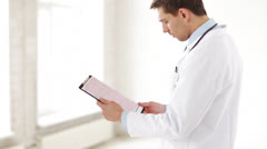 Male doctor making a prescription Stock Footage