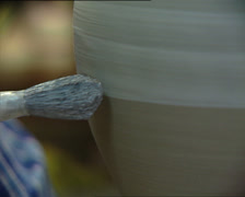 Stock Video Footage of CERAMICS craftsman painting jar close detail