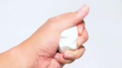 hand and white plasticine - stock footage
