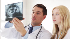 two doctors with x-ray prints - stock footage