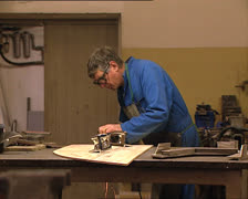 MAN WORKING with electrical sanding machine Stock Footage