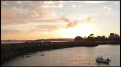 Sunset over small harbor Stock Footage