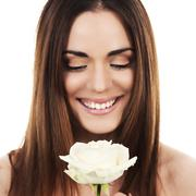 cute woman with white rose - stock photo