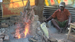 India Tamil Nadu Thanjavur metal smith making shower of sparks 2 Stock Footage