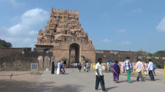 India Tamil Nadu Thanjavur Brihadeeswarar people walk through entrance 28 Stock Footage
