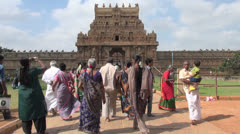 India Tamil Nadu Thanjavur Brihadeeswarar women in saris on walkway 26 Stock Footage