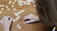 Senior Citizen doing a word puzzle Stock Footage