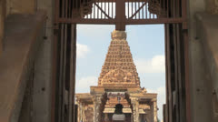 India Tamil Nadu Thanjavur Brihadeeswarar gopuram framed by doorway 22 Stock Footage