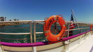 Aft Life Ring Of Aqualink Boat Leaving Alamitos Bay Stock Footage