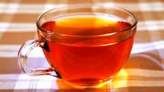 hot tea in transparent mug - stock footage