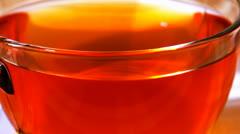 Hot tea in transparent mug Stock Footage
