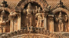 India Tamil Nadu Thanjavur Brihadeeswarar roof sculpture warriors 9 Stock Footage