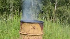 Smoked food prepare rusty barrel smoke house and firewood burn Stock Footage
