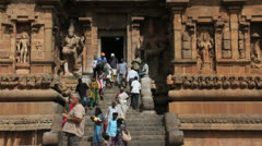 India Tamil Nadu Thanjavur Brihadeeswarar visitors descend steps 6 Stock Footage
