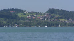 Lake Mondsee  lake shore with village at opposite side Stock Footage