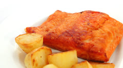 Fried salmon and potatoes Stock Footage