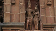 India Tamil Nadu Thanjavur temple sculpted figures in casual pose Stock Footage