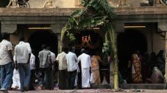 India Tamil Nadu Thanjavur temple palm leaf over entrance Stock Footage