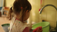 Little Baby Girl Dish Washes Stock Footage