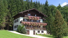 Austrian chalet with red colored planters Stock Footage