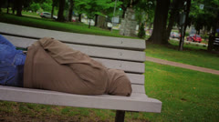 Homeless Man on Park Bench Stock Footage